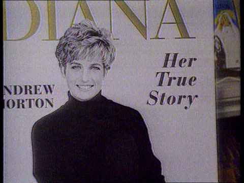 princess of wales agrees to divorce; tx 15.6.92 itn int/june 1992 london cms advertising board for book 'diana' by andrew morton pull out as copies... - relationship difficulties stock videos & royalty-free footage