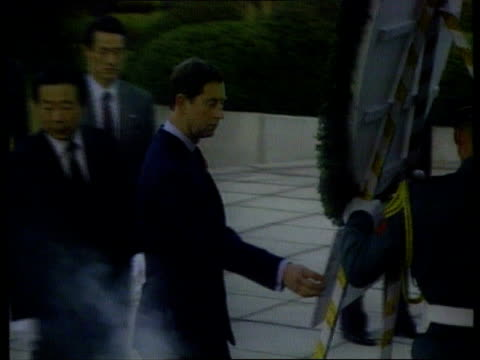 princess of wales agrees to divorce; tx 2.11.92 itn ext/2.11.92 s korea: seoul tms side charles and others along with wreath at cemetery cms diana... - 離婚点の映像素材/bロール