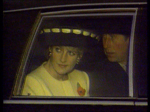 princess of wales agrees to divorce; tx 2.11.92 itn night/nov 92 s korea: seoul cms side diana and charles seated in back of car (seen thru window... - 離婚点の映像素材/bロール