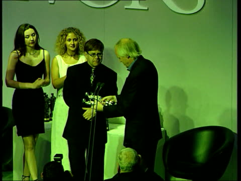 anniversary of death London W1 Grosvenor House Hotel Int TBV Elton John onto stage and receives 'Ivor Novello' award for 'Candle in the Wind' being...