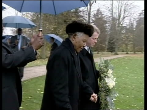 burrell trial collapses; pool via aptn northamptonshire: althorp house: raining former south african president nelson mandela along with earl spencer... - northamptonshire stock videos & royalty-free footage