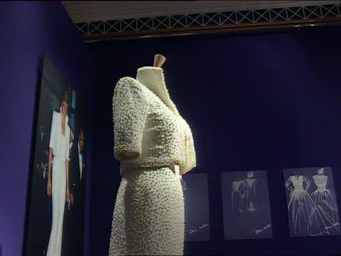 """clothes auction:; c) ltn: england: london: christie's: int cms sign - """"dresses from the collection of diana, princess of wales"""" with photo of diana... - formal stock videos & royalty-free footage"""