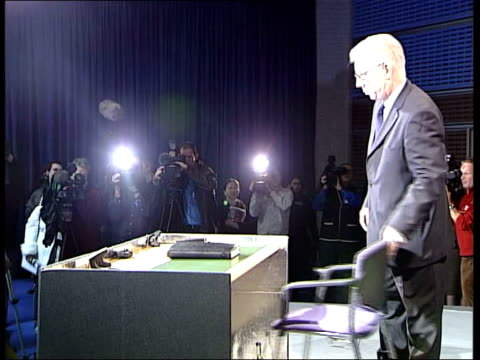 Coroner orders investigation ITN ENGLAND London Westminster Queen Elizabeth II Conference Centre Royal Coroner Michael Burgess walking to desk with...