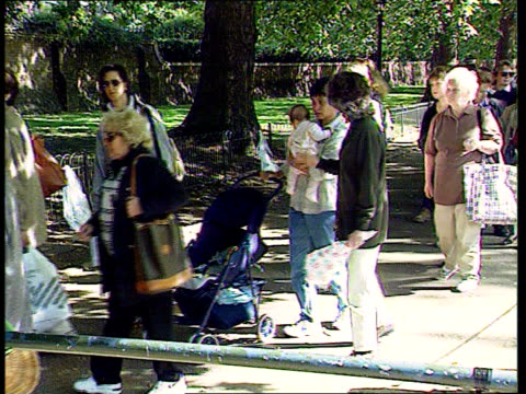 princess of wales death: mourning/funeral; princess of wales death: mourning/funeral; itn england: london: st james palace: people queueing to sign... - grief stock videos & royalty-free footage