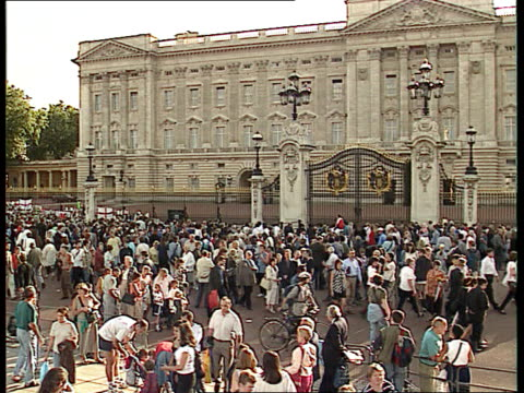 royal family the mall ts huge crowd with cameras seen moving through tracking andrew and edward ms andrew and edward towards through crowds and past... - funeral stock videos & royalty-free footage