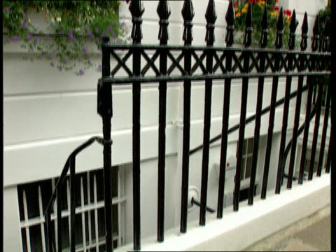 harley st la wrought iron balcony of building tilt down railings and lower windows tms wiring seen on table inside by window unknown location int cms... - safety rail stock videos & royalty-free footage