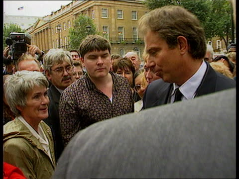 funeral; b)nat: itn england: london: downing street: tony blair mp shaking hands with crowds and expressing grief at dianas death sot downing street:... - grief stock videos & royalty-free footage
