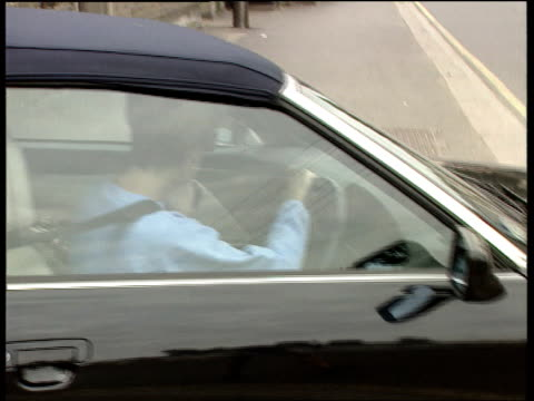 """malicious telephone calls; england: london: chelsea: """"harbour club"""" : ext diana, princess of wales drives audi car towards l-r & waits for gap in... - driving stock videos & royalty-free footage"""