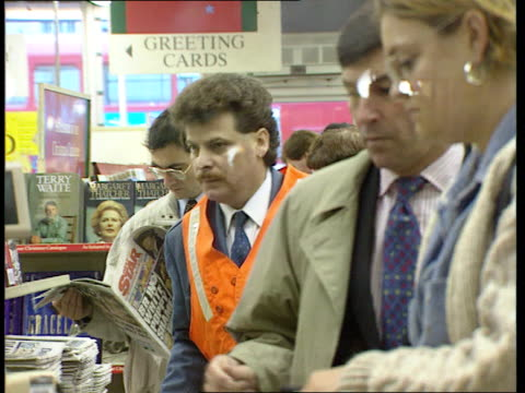 reactions EXT MS People buying papers at vendor Kings Cross MS People queue to buy papers in WH Smith CMS Ditto CMS Lord MacGregor intvwd SOT Mirror...