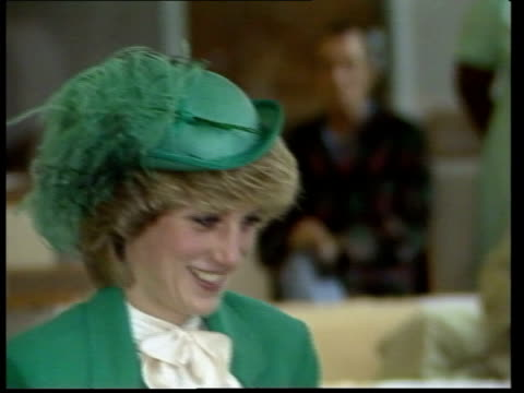 princess of wales opens hospital; england, london, bethnal green diana into ward pull out as walks down ward diana chats male patient diana smiling... - ダイアナ妃点の映像素材/bロール