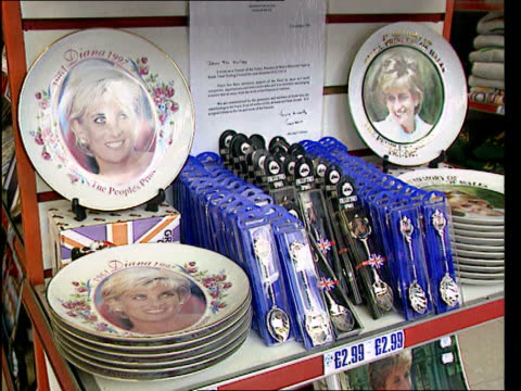 princess of wales registered trade mark turned down england london princess diana mugs on sale with sign above 'a 10% donation from the proceeds of... - souvenir stock videos and b-roll footage