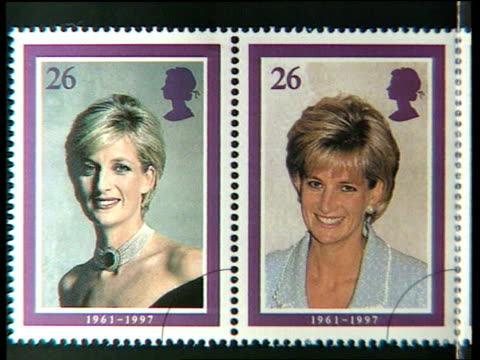 princess of wales stamps; itn england int royal mail stamps designed to commemorate the princess of wales featuring different portraits of her - ロイヤルメール点の映像素材/bロール