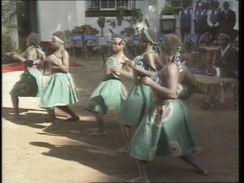 Princess of Wales trip **** FOR RUSHES SEE R10079314 Harare MS Diana Princess of Wales along past young drummers PAN LR MS Girl tribal dancers CMS...