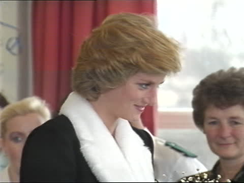 princess of wales visits aids hospice; england: london: bethnal green: mildmay mission hospice: int various of diana, princess of wales enters... - bouquet stock videos & royalty-free footage