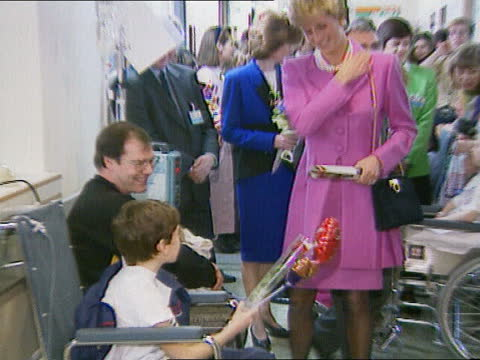 princess of wales visits great ormond street hospital; b)nao: england: london: great ormond street hospital: ext bv line of nurses waiting for... - itv lunchtime news stock videos & royalty-free footage