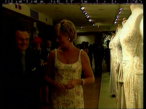 Princess says goodbye to gowns/ Landmines NAT New York Christies LMS Princess of Wales viewing dresses ZOOM IN CMS dress on display EXT TMS Princess...