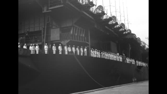 uss princeton arrives at dock white unformed sailors stand at edge of decks / filipinos step to gangplank / vs dignitaries seated with coffin draped... - philippines flag stock videos & royalty-free footage