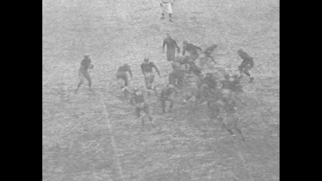vídeos de stock e filmes b-roll de princeton nj game in snowstorm / princeton kicks off to dartmouth and tackles runner / princeton takes possession and fumbles / nairne pulls old... - dartmouth