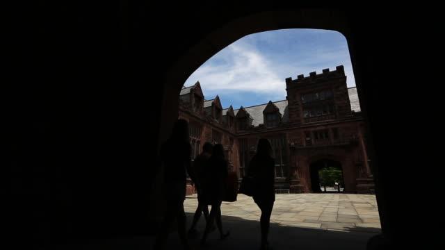 Princeton University campus Family walks into a courtyard
