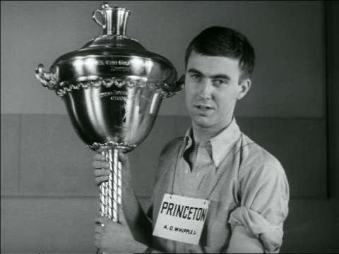 B/W 1936 Princeton University student holding large trophy after winning shaving contest / newsreel