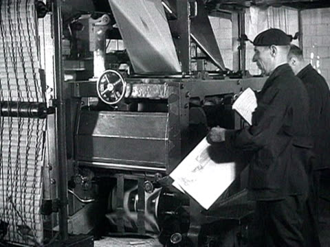 ms print workers reading newly issued official statement about 'khrushchev's meeting with mao during visit to china' audio / moscow russia - anno 1958 video stock e b–roll