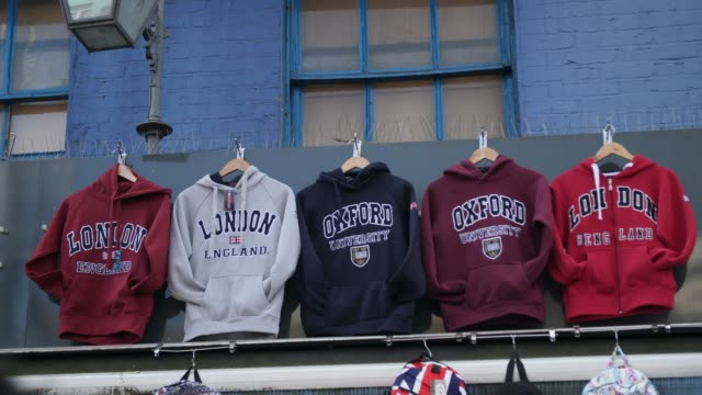 Printed hoodies displayed at street market stall, Camden