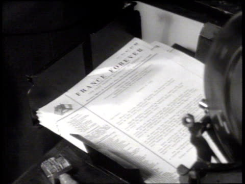 printed newsletter 'france forever' feeding into tray ms collection newspapers headlines produced by french in exile cu cross of lorraine pin on... - newsletter stock videos & royalty-free footage