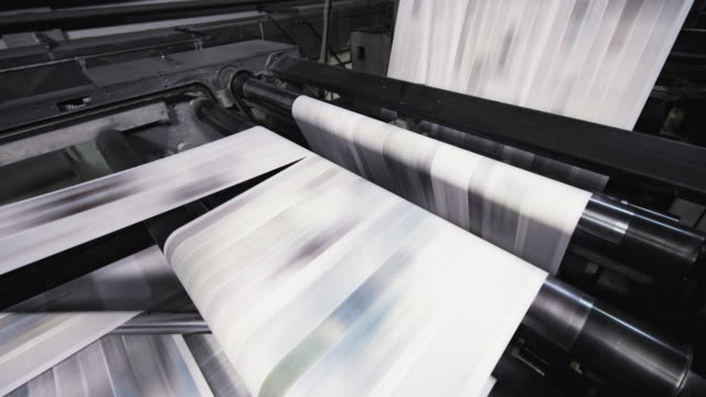 ld printed paper sheet running through the machine in the printing factory - printing out stock videos & royalty-free footage