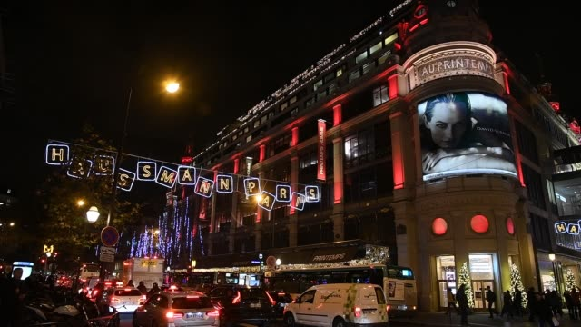 vidéos et rushes de printemps department store is seen illuminated with the christmas lights on december 4 2018 in paris france - store