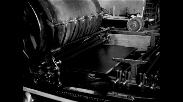 printer using newspaper printing guiding paper on machine plates under rolling paper ms front page of dalhart newspaper 'disaster threatens farmers... - 1937 stock videos and b-roll footage