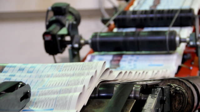 printing of newspapers - folded paper stock videos and b-roll footage