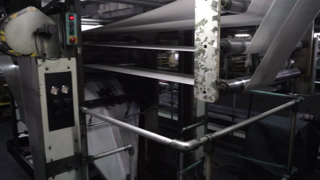 printing of the apple daily newspaper, published by next media ltd., at the company's printing facility. hong kong police arrested next digital... - journalismus stock-videos und b-roll-filmmaterial