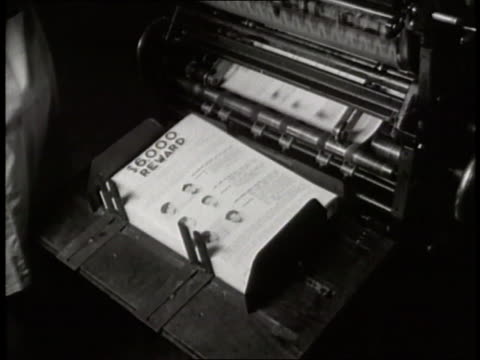 printing press produces wanted posters. - 1930 stock-videos und b-roll-filmmaterial