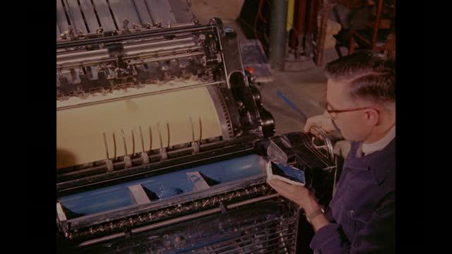 1960 - printing press turning out menus, united kingdom - man and machine stock videos & royalty-free footage