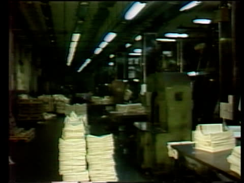"""printing strike; poland: warsaw bundles of papers loaded more r-l into back of lorry cms express """"wiec"""" pull up * re tx'd gv interior... - zeitschrift stock-videos und b-roll-filmmaterial"""