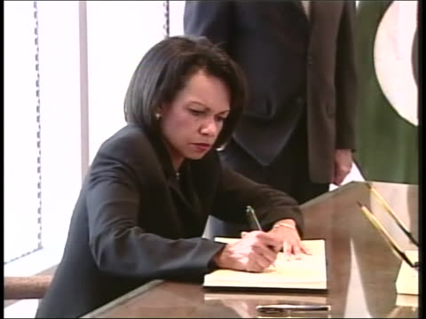 prior to speaking to the press national security advisor condoleeza rice signs paperwork at the pakistan embassy after the assassination of benazir... - crime or recreational drug or prison or legal trial stock videos & royalty-free footage