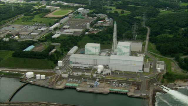 prior to the earthquake and subsequent tsunami in march 2011 aerial: fukushima daiichi nuclear power station at fukushima daiichi nuclear power... - nuclear power station stock videos & royalty-free footage