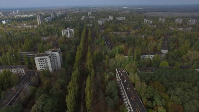 pripyat abandoned town near chernobyl nuclear power plant. flight backward above lenin-avenue. part 2of2 - 1985 stock videos & royalty-free footage