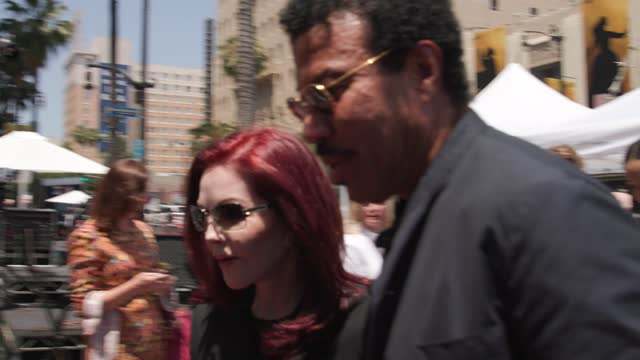 priscilla presley and lionel richie attend a ceremony honoring television producer nigel lythgoe with a star on the hollywood walk of fame on july... - プリシラ プレスリー点の映像素材/bロール