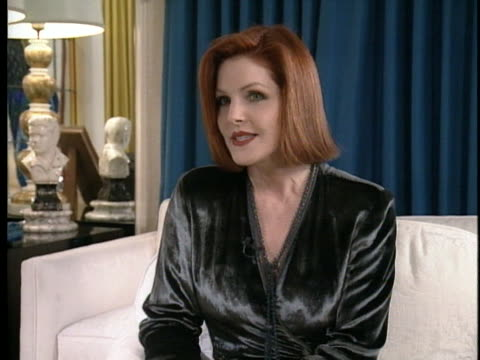 priscilla presley discusses her continuing visits to graceland during an interview in 1994. - プリシラ プレスリー点の映像素材/bロール