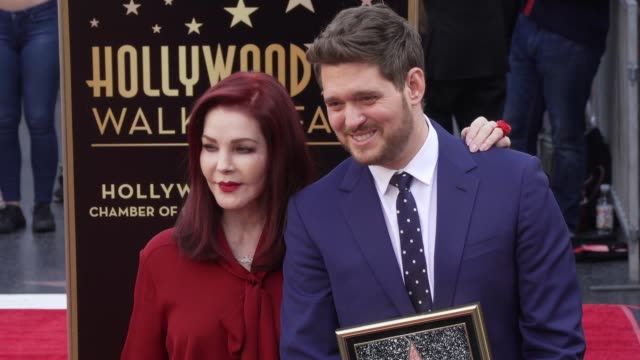 priscilla presley, michael buble at michael bublé star on the hollywood walk of fame in los angeles, ca 11/16/18 - プリシラ プレスリー点の映像素材/bロール