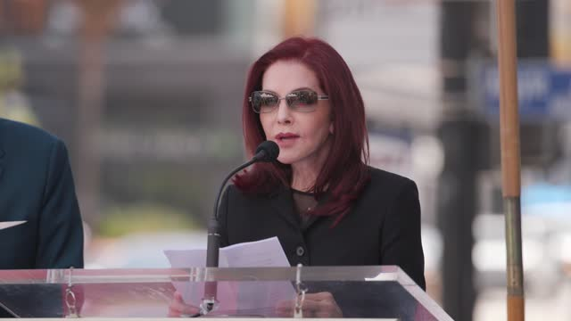 priscilla presley speaks onstage at a ceremony honoring nigel lythgoe with a star on the hollywood walk of fame on july 09, 2021 in hollywood,... - プリシラ プレスリー点の映像素材/bロール