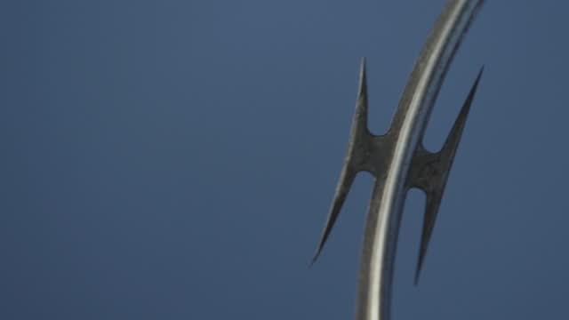 prison barbed wire fence close up found at jails and correction facilities, mass incarceration in the u.s. - metalltråd bildbanksvideor och videomaterial från bakom kulisserna