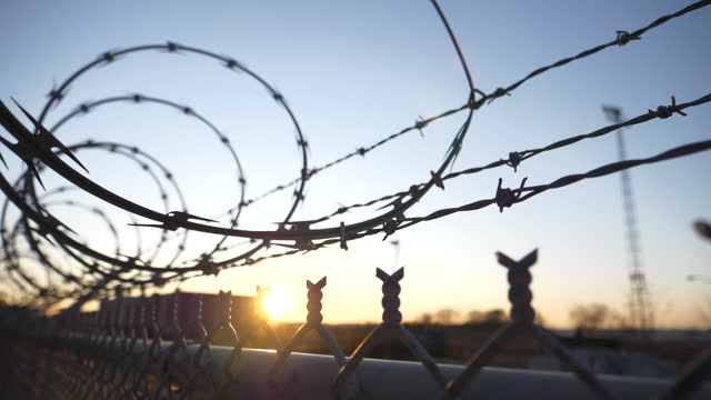 prison barbed wire fence found at jails and correction facilities, mass incarceration in the u.s. - sentencing stock videos & royalty-free footage