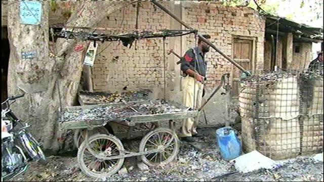 prison break frees 250 taliban inmates pakistan ext burnt out cart men along towards prison building prison entrance - prison break stock videos & royalty-free footage