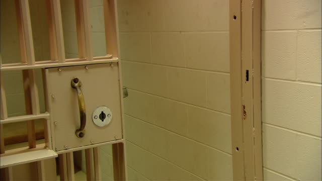 ms prison cell door closing and opening/ new jersey - security screen stock videos & royalty-free footage