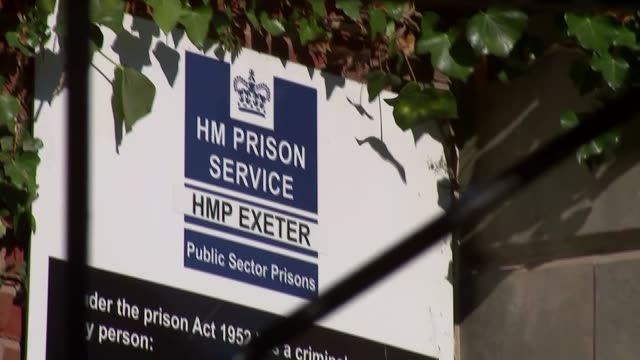 devon exeter ext gvs hm prison exeter exeter prison and 'hmp exeter' entrance sign and razor wire atop perimeter fence - shaving equipment stock videos & royalty-free footage