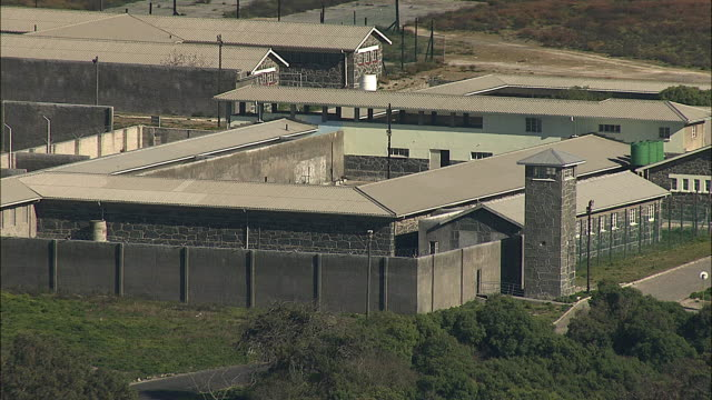 aerial ws prison famous for nelson mandela's stay, robben island, western cape, south africa - prison stock videos & royalty-free footage
