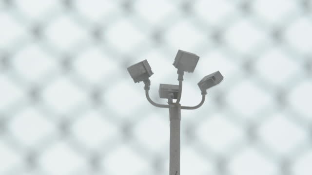 prison fence and security lights at jails, correction facilities, mass incarceration in the u.s. - security screen stock videos & royalty-free footage
