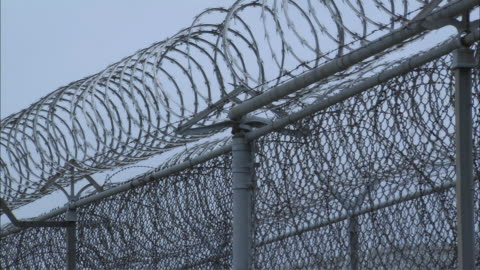 zo prison fence topped with barbed wire / huntsville, texas, united states - b roll stock videos & royalty-free footage